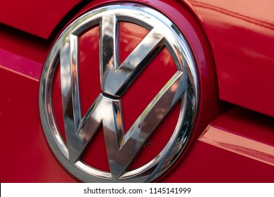 Berlin, Germany - July 6, 2018: Volkswagen motor company emblem on red car. Volkswagen Group is a German automobile manufacturing group based in Wolfsburg, Germany, and founded in 1937