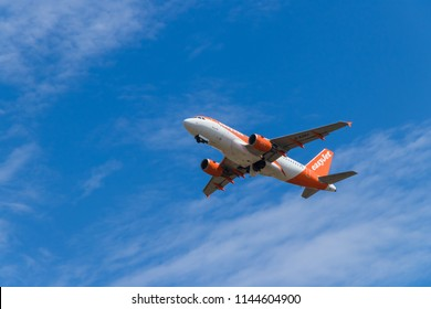 BERLIN, GERMANY - JULY 7, 2018: easyJet Airbus A319-111 takes off from Tegel airport in Berlin. The A319 carries up to 160 passengers and has a maximum range of 3,700 nmi.