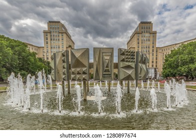 Berlin, Germany - July 7th 2016 - main avenue during of the GDR (East Germany), Karl Marx Allee presents many beautiful buildings. Here in particular an example of its socialist architecture