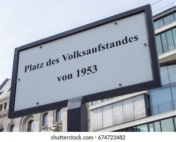 BERLIN, GERMANY - JULY 9, 2017: Street Sign Platz des Volksaufstandes von 1953, Meaning Place of The Popular Uprising of 1953 In German Language, Berlin