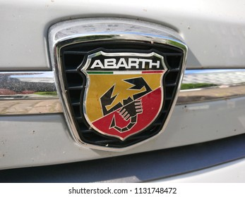 Berlin, Germany - July 9, 2018: Abarth 595 car logo. Abarth SpA is a racing car and road car maker founded by Italo-Austrian Abarth in 1949. Its logo is a shield with a scorpion on red and yellow back