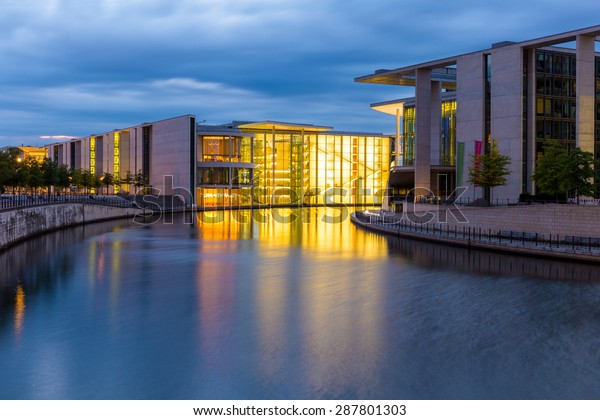 Berlin, Germany - June 01, 2015. The german chancellery building in the government district in Berlin at night. The Paul Loebe House (left) and the Marie Elisabeth Lueders House (right) on the Spree.