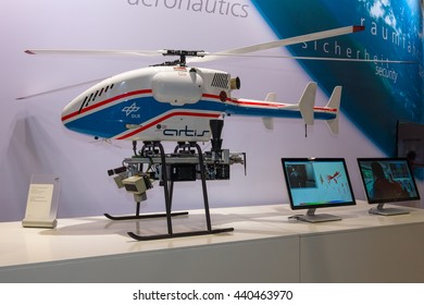 BERLIN, GERMANY - JUNE 01, 2016: The stand of German Aerospace Center (DLR). Helicopter Drone SuperARTIS (Autonomous Rotorcraft Testbed for Intelligent Systems). Exhibition ILA Berlin Air Show 2016.