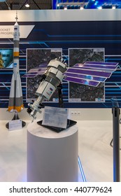 BERLIN, GERMANY - JUNE 01, 2016: The stand of State Space Corporation - Roscosmos (Russia). Model of satellite Resurs-P. Exhibition ILA Berlin Air Show 2016.