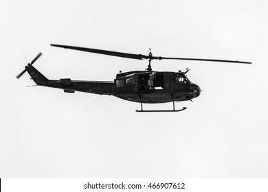 BERLIN, GERMANY - JUNE 02, 2016: Demonstration flight of military helicopter Bell UH-1 Iroquois. German Army. Black and white. Exhibition ILA Berlin Air Show 2016