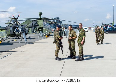 BERLIN, GERMANY - JUNE 03, 2016: Military police on the airfield. Exhibition ILA Berlin Air Show 2016