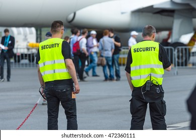 BERLIN, GERMANY - JUNE 03, 2016: Security staff at the airfield. Exhibition ILA Berlin Air Show 2016