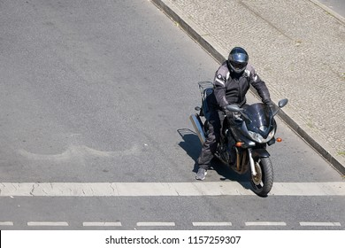 BERLIN, GERMANY – JUNE 07, 2018: Motorcyclist waits at a crossroads in the City center of Berlin