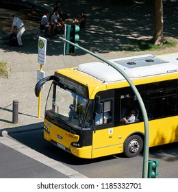 BERLIN, GERMANY - JUNE 07, 2018: yellow bus at a bus stop in the district Charlottenburg in the city center of Berlin