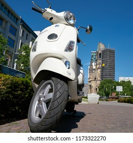 BERLIN, GERMANY – JUNE 08, 2016: Parked scooter in downtown Berlin. In the background, the Breitscheidplatz is the Memorial Church.