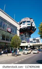 BERLIN, GERMANY – JUNE 08, 2016: Popular shopping street in the district of Berlin-Steglitz with the Bierpinsel, the landmark in the Schlossstraße