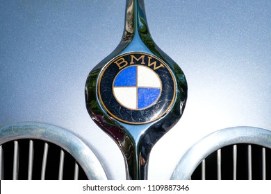 Berlin, Germany - june 09, 2018: Closeup of the BMW logo design / brand name of on Oldtimer automobile at vintage car event in Berlin, Germany
