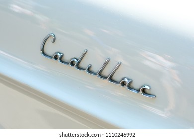 Berlin, Germany- june 09, 2018: Car design detail and CADILLAC logo / brand name lettering closeup on oldtimer automobile