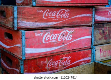 Berlin, Germany - june 09, 2018: The Coca Cola brand logo on old vintage Coca Cola boxes / case for bottles