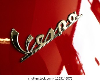 Berlin, Germany - June 1, 2018: Red Vespa scooter emblem. Vespa is an Italian brand of scooter manufactured by Piaggio. The first Vespa was manufactured in the year 1946