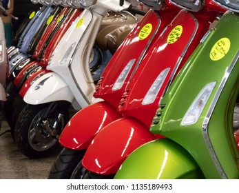 Berlin, Germany - June 1, 2018: Colourful Vespa scooters in a row for sale. Vespa is an Italian brand of scooter manufactured by Piaggio. The first Vespa was manufactured in the year 1946