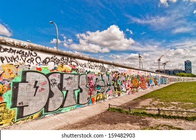 BERLIN, GERMANY - JUNE 10:  Graffiti at the East Side Gallery  on June 10, 2013 in Berlin, Germany. The East Side Gallery is the longest preserved stretch of the Berlin wall.