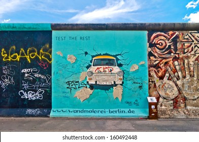 BERLIN, GERMANY - JUNE 10: painting from Birgit Kinder of the Trabant in The East Side Gallery - the largest outdoor art gallery in the world on a segment of the Berlin Wall on June 10, 2013 in Berlin