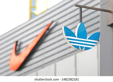 BERLIN GERMANY - JUNE 11, 2019:: Adidas company logo and Nike company logo in background