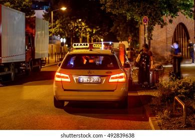 BERLIN, GERMANY - JUNE 12: Taxi car at night on the street in Berlin Treptow, Germany, Europe jun 12 2015
