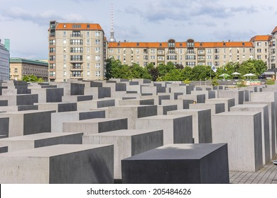 BERLIN, GERMANY - JUNE 16, 2014: Memorial to the Murdered Jews of Europe (Holocaust Memorial) - 2711 concrete blocks whit different highs and parallel alignment placed on 19.000 sqm urban area.