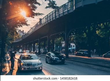 Berlin / Germany - June 19 2018: Beige taxi car Mercedes-Benz W212 E-class at the sunset city street.