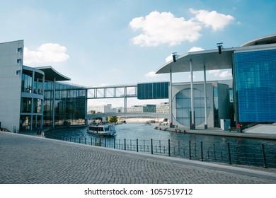 BERLIN, GERMANY - JUNE 20, 2017: urban scene with Spree river passing between Paul-Lobe-Haus building and Marie-Elisabeth-Lders-Haus building in Berlin, Germany