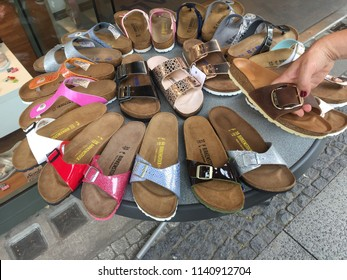 Berlin, Germany - June 20, 2018: Birkenstock sandals displayed in shoe store. The company is a famous German brand of sandals and other shoes notable for their contoured cork and rubber footbeds