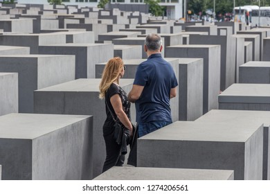 Berlin- Germany – June 2016 :  visitors at the Jewish Holocaust Memorial  (The Memorial to the Murdered Jews of Europe) designed by Peter Eisenman
