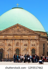 Berlin, Germany - June 2018: Group of tourists, St. Hedwig's Cathedral or Sankt Hedwigs Kathedrale, Roman Catholic cathedral, Bebelplatz in Berlin, Germany. Seat of the Archbishop of Berlin