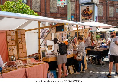 Berlin, Germany - june 2018: People on street market at Hackescher Markt in Berlin, Mitte  on a sunny summer day