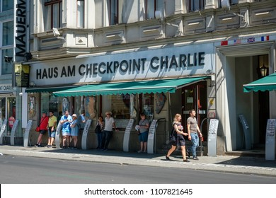 Berlin, Germany - june 2018: People in front of Haus am Checkpoint Charlie / Berlin wall museum  at former border of east and west Berlin