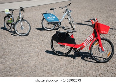 Berlin, Germany - June, 2019: Bicycle sharing bikes for rent from DEEZER, LIDL and JUMP by UBER on street in Berlin