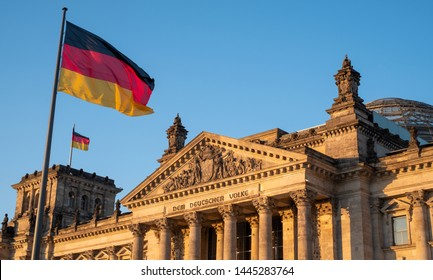 Berlin, Germany, June 2019. The Bundestag building, Parliament of the Federal Republic of Germany, with German flag flying outside. Photographed in the late afternoon during the June heatwave.
