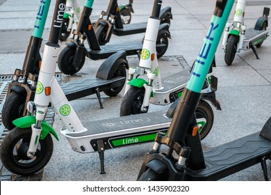 Berlin, Germany - June, 2019: Electric scooter , escooter or e-scooter of the ride sharing company LIME and TIER on sidewalk in Berlin, Germany