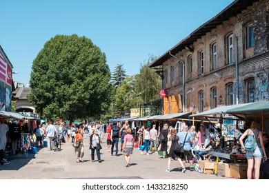 Berlin, Germany - june 2019: People on Raw flea market on a sunny sunday in Berlin, Friedrichshain