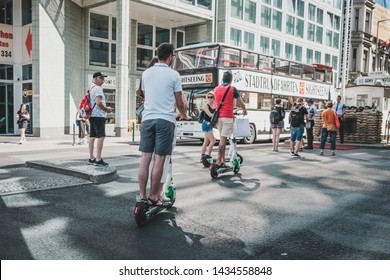 Berlin, Germany - June, 2019: Tourist group riding Electric scooter , escooter or e-scooter on street  in Berlin, Germany
