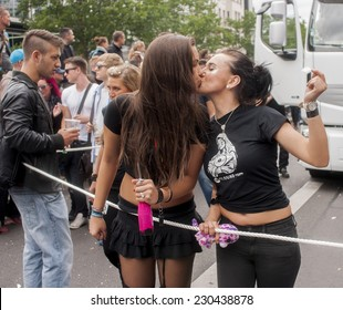 BERLIN, GERMANY - JUNE 21, 2014: Christopher Street Day. Crowd of people Participate in the parade celebrates gays, lesbians, and transgenders.