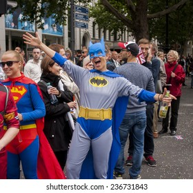 BERLIN, GERMANY - JUNE 21, 2014:Christopher Street Day. Crowd of people Participate in the parade celebrates gays, lesbians, and transgenders. Prominent in the image, participans dressed as Batman.