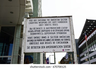 BERLIN ,GERMANY- JUNE 21, 2017: Historical sign at former East West Berlin border. Former Checkpoint Charlie, old sign with warning of leaving the american sector after Second World War and Cold War