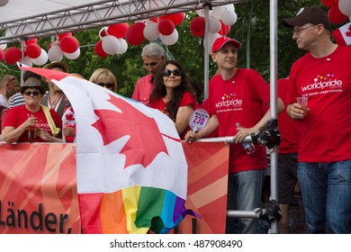 BERLIN, GERMANY - JUNE 22, 2013: Christopher Street Day. The annual European LGBT celebration and demonstration for the rights of LGBT people. Participants from Canada with flags.