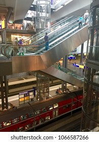 BERLIN, GERMANY - JUNE 24, 2017:  Passengers and shoppers travel through the main central station in Berlin - Hauptbahnhof.