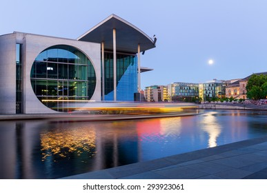 Berlin, Germany - June 30, 2015. Part of the german chancellery building (Marie Elisabeth Lueders House)  in the moonlight on the river Spree in the government district.