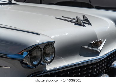 Berlin, Germany - June 30, 2019: White Cadillac classic car. Founded in 1902, Cadillac is a division of the U.S.-based General Motors (GM) that markets luxury vehicles worldwide