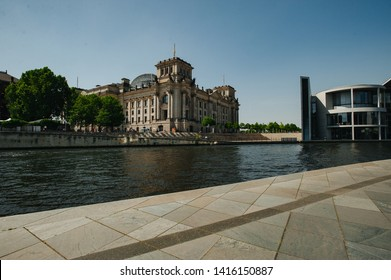 Berlin, Germany - June 4, 2019: Tourist river Spree at German Reichtag building and Paul Löbe Haus in Berlin