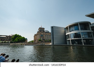 Berlin, Germany - June 4, 2019: Tourist sightseeing tour on river Spree at German Reichtag building and Paul Löbe Haus in Berlin