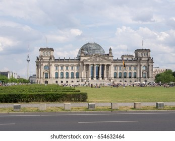 BERLIN, GERMANY - JUNE 5, 2017: Tourists In Front of Reichstag Building With TV Tower In Background In Berlin