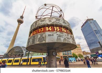 BERLIN, GERMANY - JUNE 6, 2012: Berlin's Alexanderplatz, Weltzeituhr (World Time Clock), and TV Tower in Berlin. Alexanderplatz is the central transportation hub of Berlin