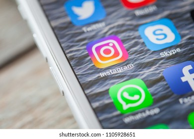 BERLIN, GERMANY - JUNE 6, 2018: Close up to app of social media photo community Instagram on the screen of an iPhone 7 Plus with personalized background.