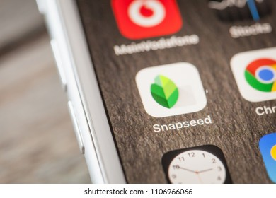 BERLIN, GERMANY - JUNE 6, 2018: Close up to Google Snapsee photo editing app on the screen of an iPhone 7 Plus with personalized background.